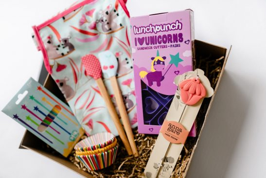 Get your gorgeous kids in the kitchen with our 'Little Chefs Baking Hamper' packed full of beautiful goodies! Including a Lunch Punch unicorn sandwich cutter set, rainbow Stix, a cute koala kids apron, cupcake cases, a cake tester and set of 2 mini spatulas. This is just the cutest gift!