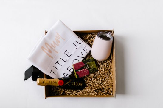 The 'Mumma Loves Moet' hamper is the ultimate luxe gift for a champagne loving mum. Filled with a 200ml bottle of Moet champagne, block of gourmet Pana chocolate, a stainless steel wine tumbler and our bespoke 'Mum. A Title Above Queen' premium tea towel.