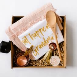 'Grandma's Baking Hamper' is the ultimate gift for a special grandma who loves to cook. Filled with our bespoke 'What happens at Grandma's, stays at Grandma's' premium tea towel, a classic Tara Dennis linen apron, a wooden spoon, and Stephanie Alexander copper measuring cup and spoon sets.