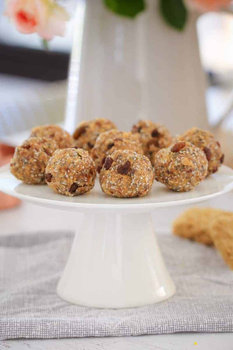 Bliss balls on a cake stand made with weet-bix and sultanas.