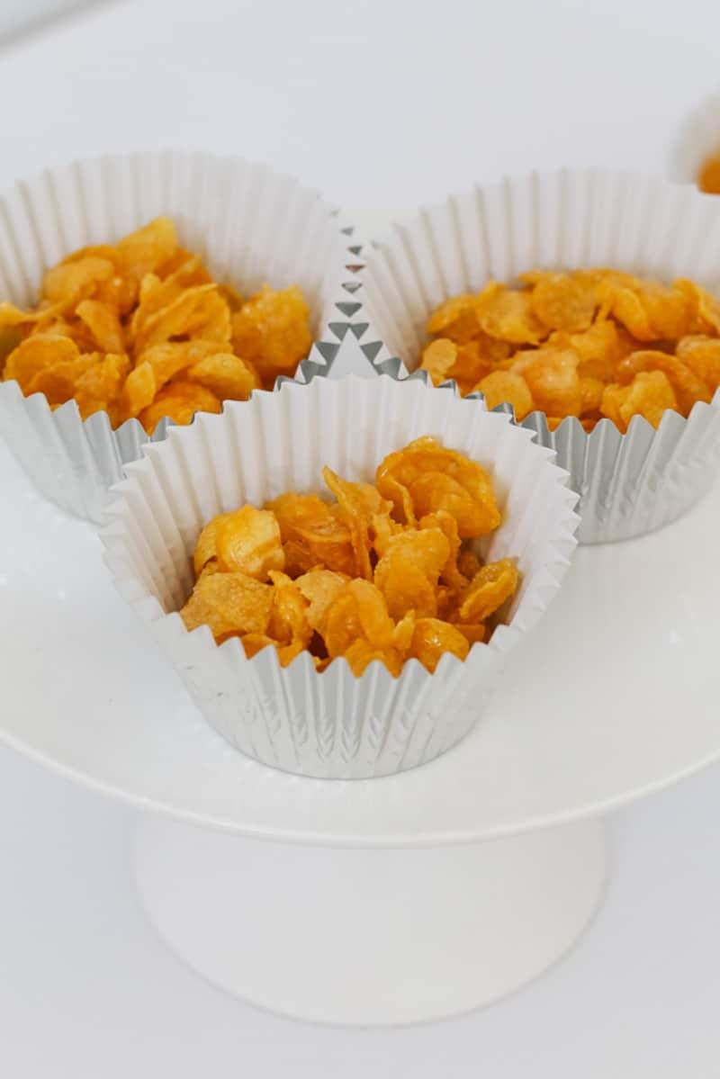 Cornflake honey joys on a cake plate.