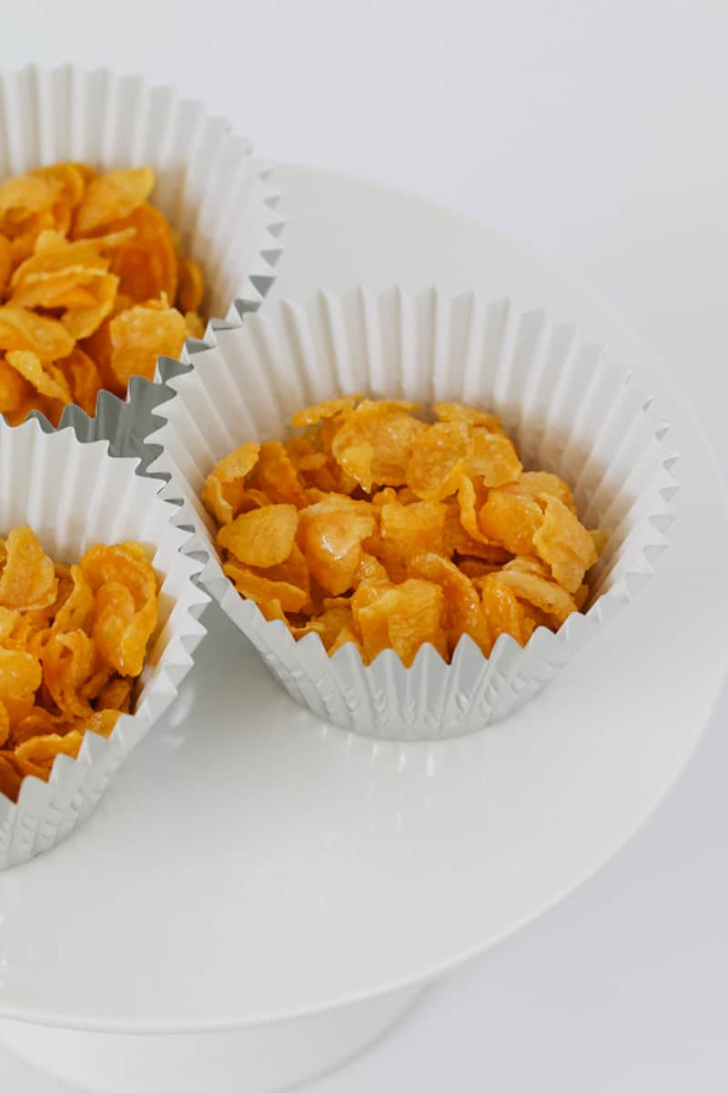 Kids party food cornflakes in cupcake cases.