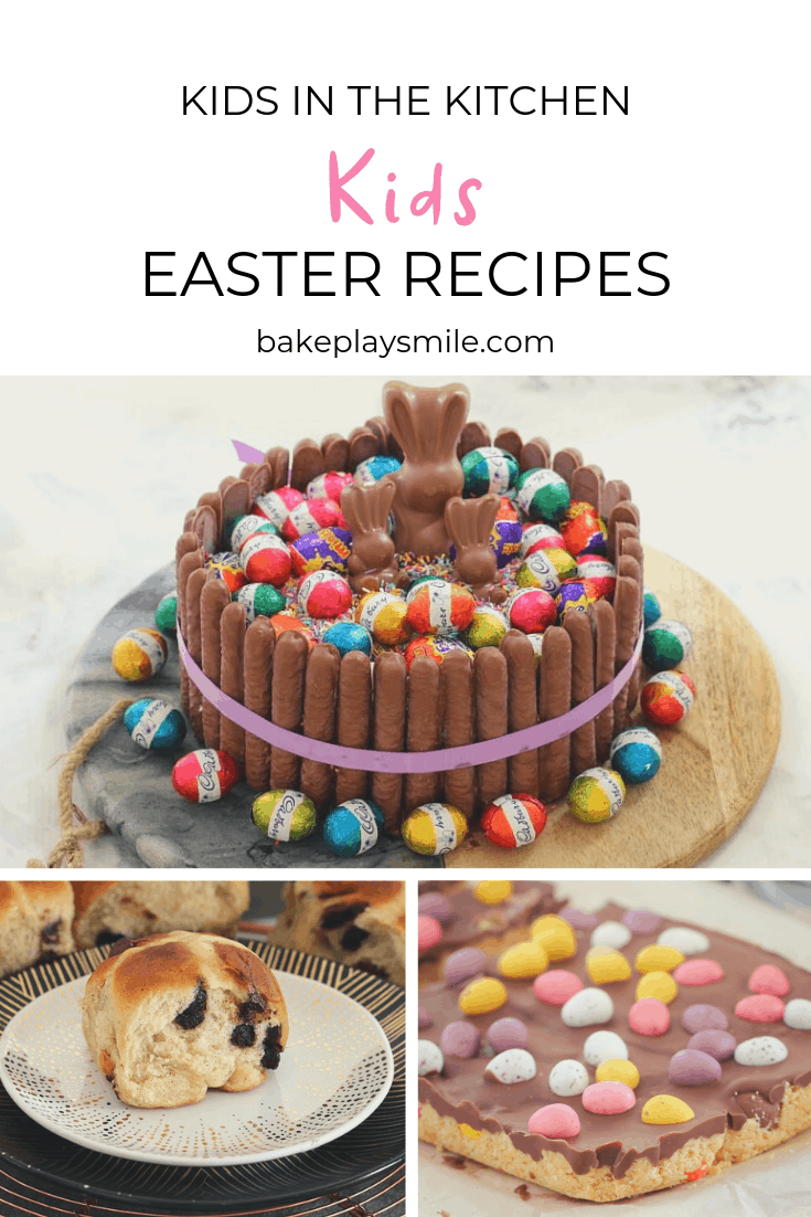 Cake decorated with chocolate finger biscuits, chocolate bunnies and mini Easter eggs on a board