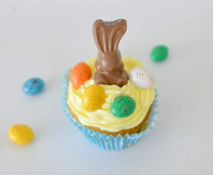 Little Easter cupcakes decorated with Malteser bunnies and speckled Easter eggs.