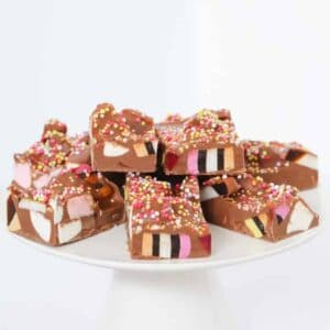 Pieces of rocky road on a cake stand.