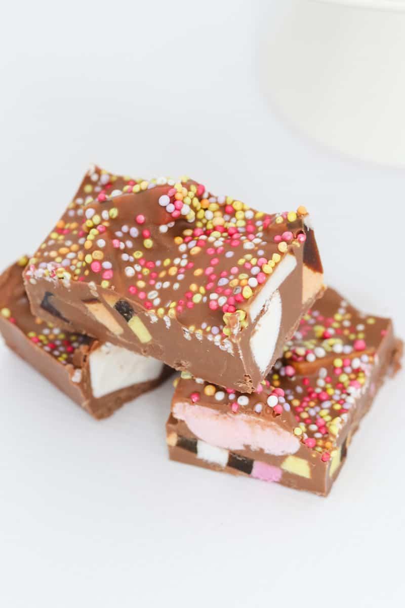 Sprinkles on top of milk chocolate rocky road.