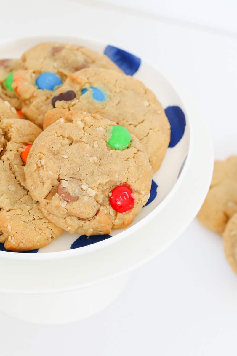 A peanut butter cookie with a red and green M&M.