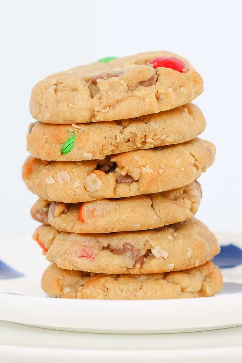 A stack of peanut butter cookies with M&Ms and oats.
