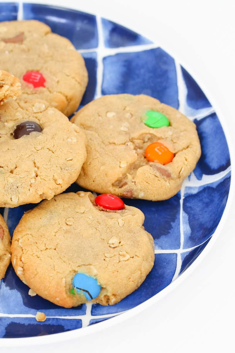 A plate of chocolate and peanut butter biscuits with colourful M&Ms.