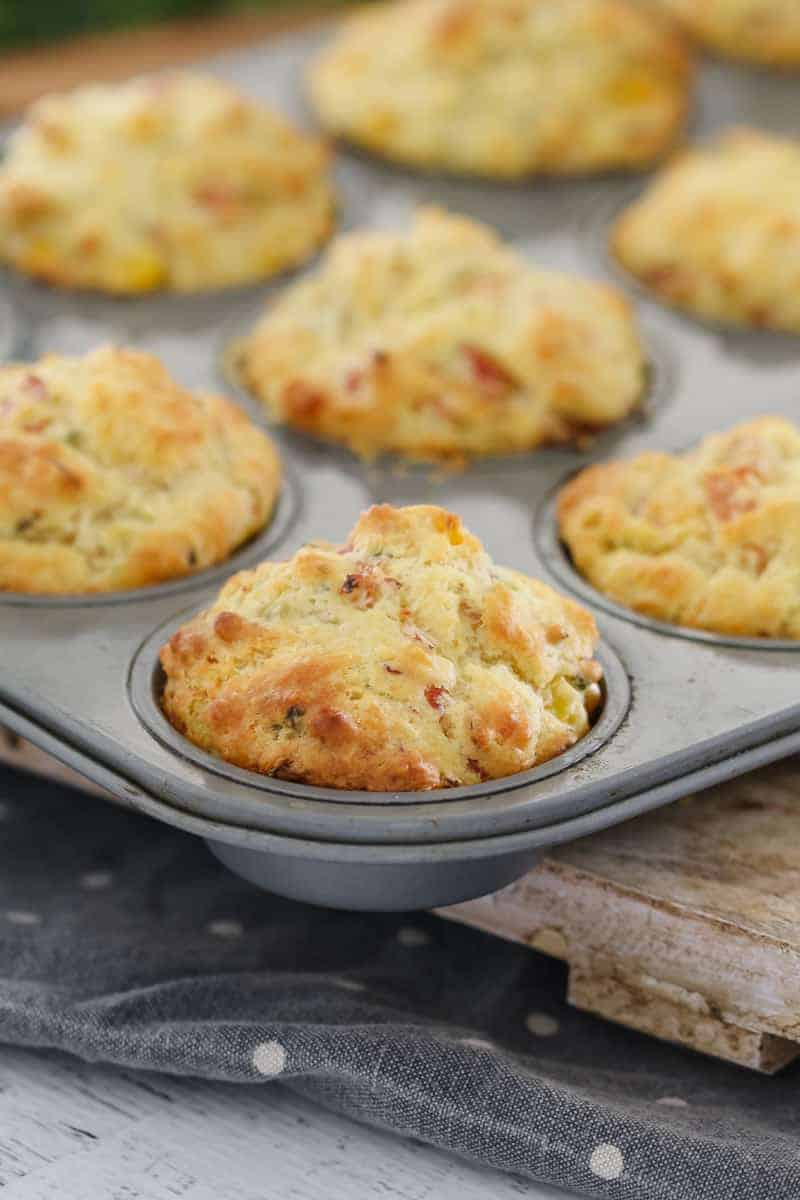 A batch of savoury muffins in a muffin pan.