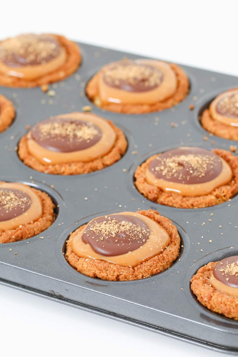 Caramel and chocolate on top of butternut snap biscuits.
