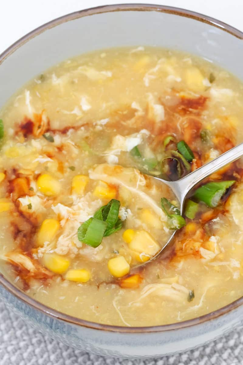 A spoonful of chicken and corn soup.
