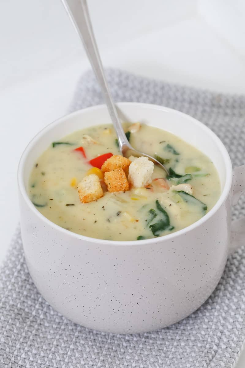 Croutons on top of chicken and vegetable soup.