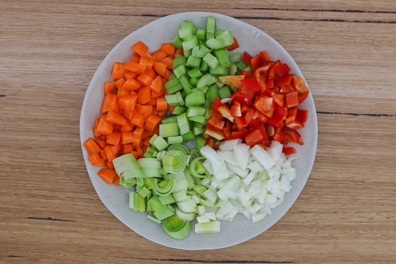 A plate of vegetables for chicken soup.