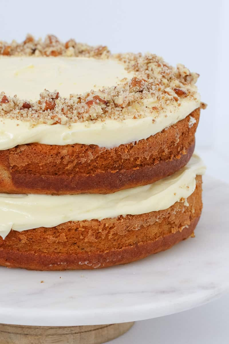 A two layer banana and pineapple cake with frosting.