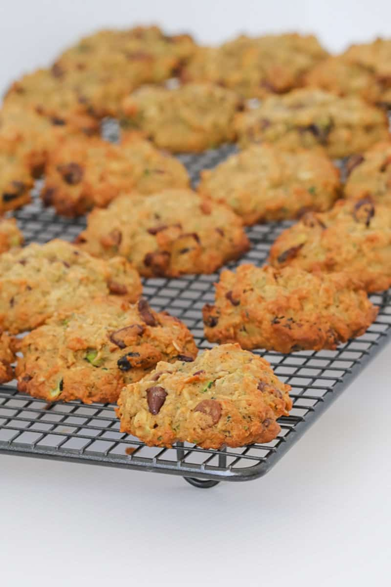 Zucchini and chocolate chip cookies cooling on a wire rack.