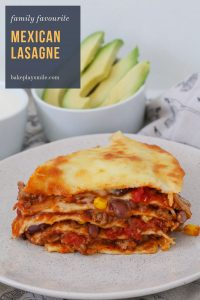 A healthy and delicious Mexican Lasagne recipe that the whole family will love... layered with tortilla wraps, a beefy bean taco mince and cheese!