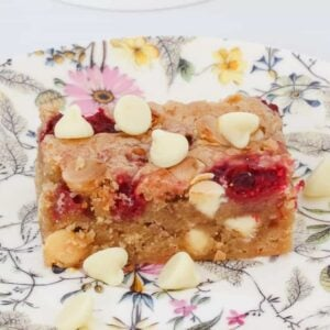 Sweet, buttery and fudgy Raspberry & White Chocolate Blondies with tart bursts of raspberries and crunchy chocolate in every bite! The perfect chewy blondie recipe.