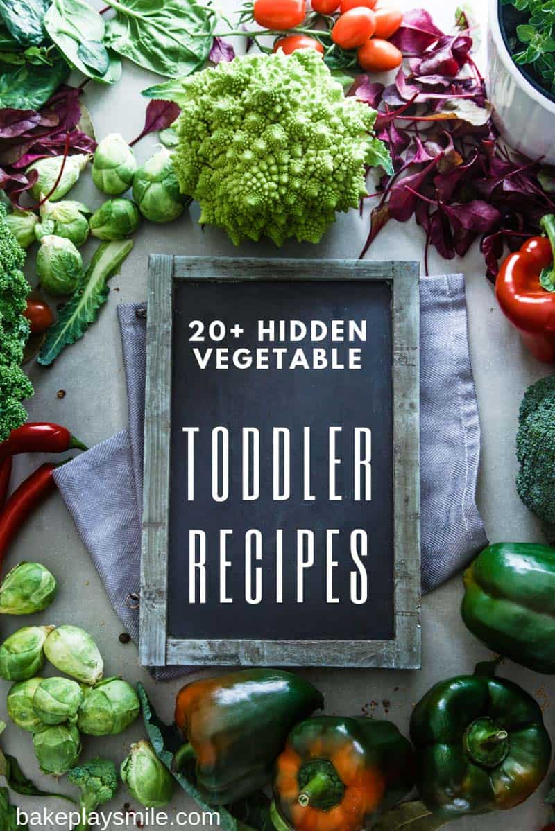A sign for Toddler Recipes surrounded by colourful fresh vegetables.