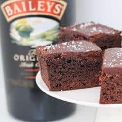 A rich and deliciously boozy chocolate Baileys Brownies recipe made with Irish cream liqueur and topped with a smooth chocolate frosting.