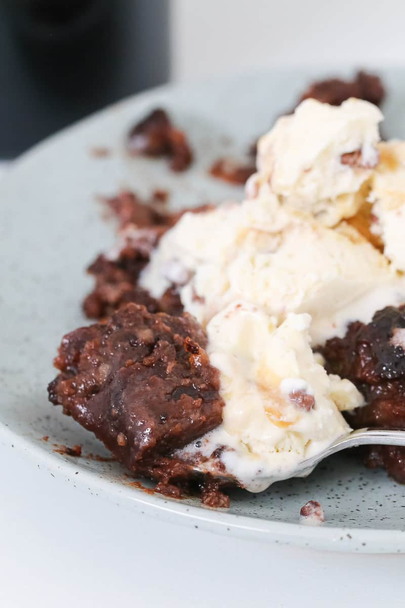 A spoonful of chocolate pudding and ice-cream.