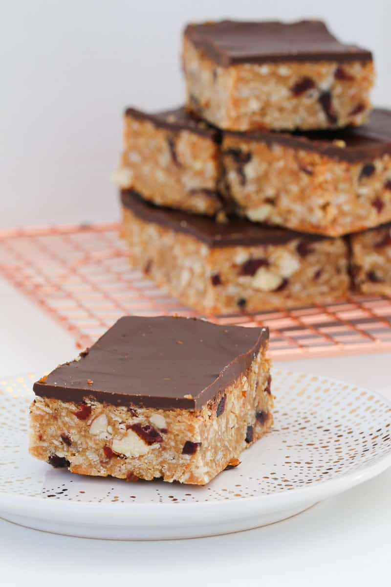 A granola bar with a layer of chocolate on top.
