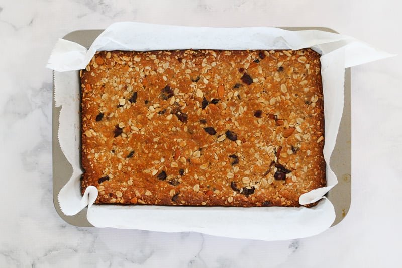 A slice tin with golden baked muesli bars.