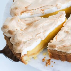 A classic homemade Lemon Meringue Pie recipe with three perfect layers of melt-in-your-mouth pie crust, a creamy lemon filling and a fluffy meringue topping.