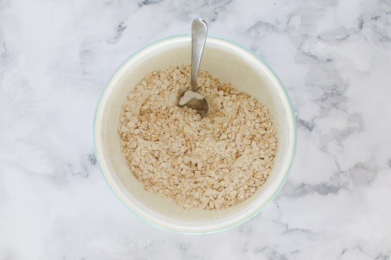 Flour and oats in a mixing bowl.