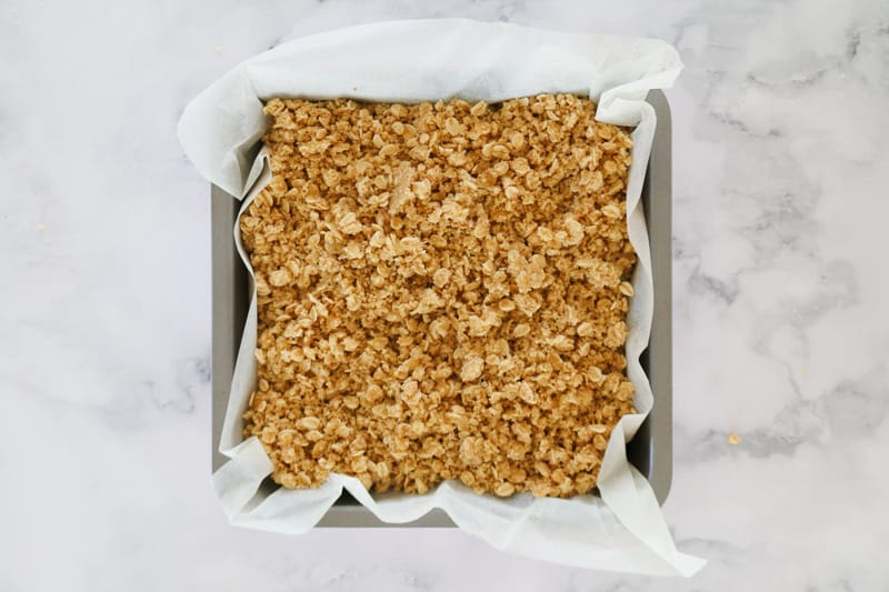 Oat crumble in a square baking tin.