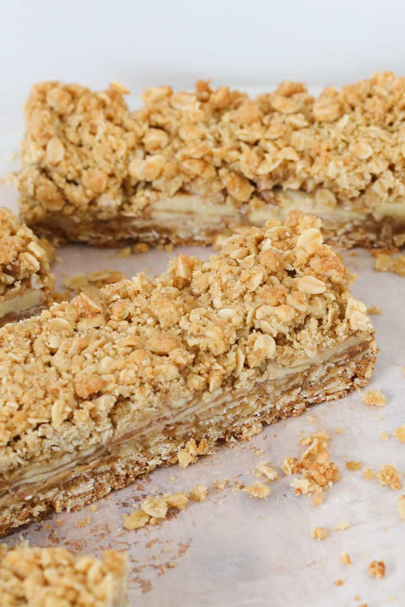 A long slice of apple crumble bars.