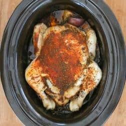 Our healthy slow cooker roast chicken & vegetables recipe is the perfect mid-week family meal (includes tips for getting a crispy skin!).