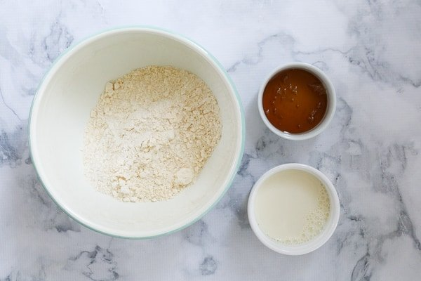 Individual bowls with self-raising flour, golden syrup and milk.