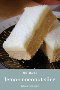 Two pieces of lemon slice with coconut frosting.