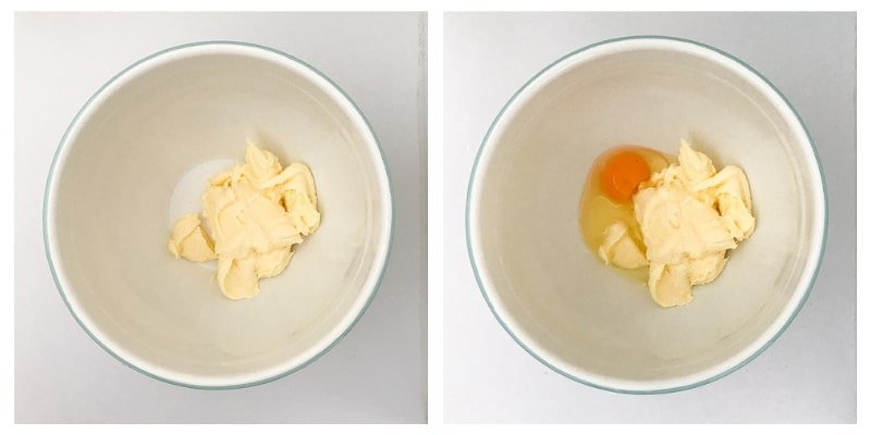 Butter and sugar creamed together in a bowl and an egg being added.