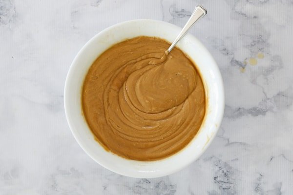Caramel fudge mixture in a bowl.