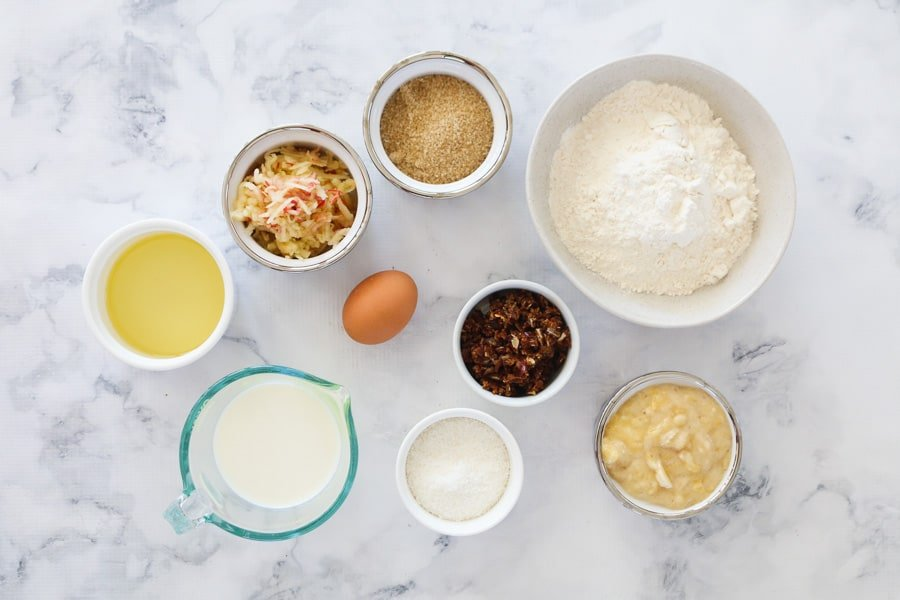 The ingredients needed for apple, banana, coconut and date muffins.