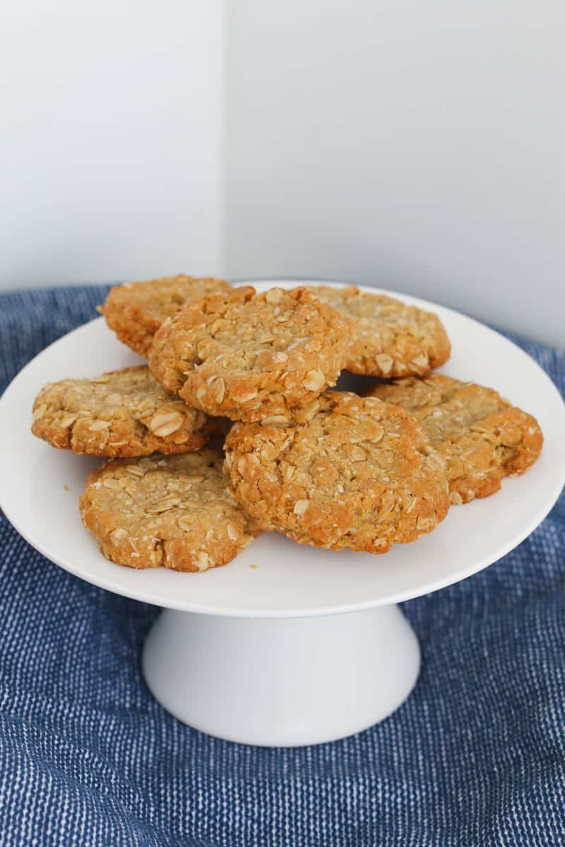 A white cake plate of oat cookies.