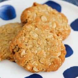 A plate of 3 ANZAC biscuits.