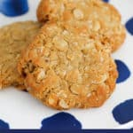 A white and blue plate with ANZAC biscuits.