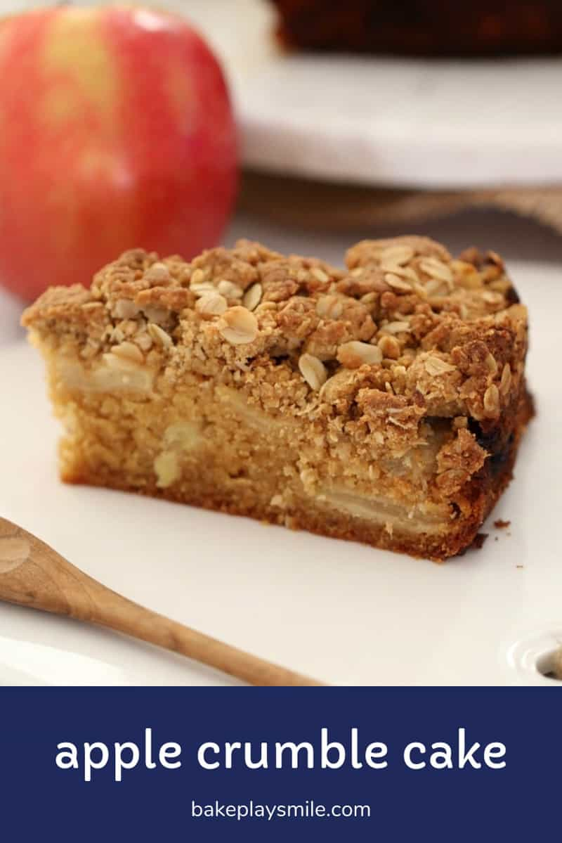 A piece of apple cake with crunchy streusel on top.