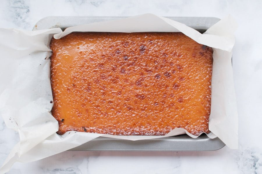 Caramel slice that's just come out of the oven and is firm on top.