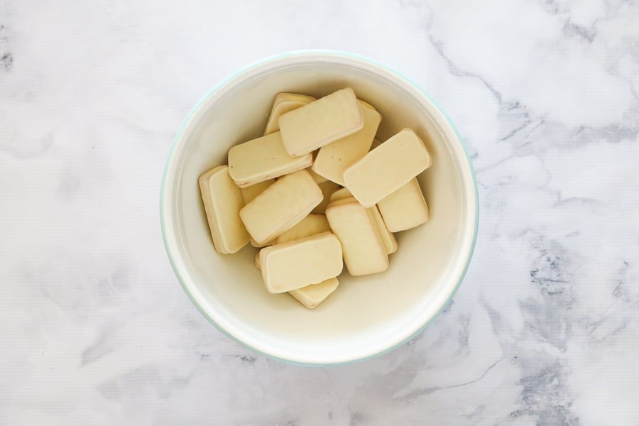 A bowl of white chocolate Tim Tams.