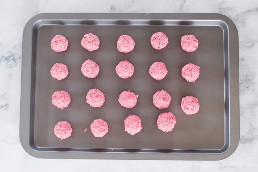 Pink coconut balls mixed with sweetened condensed milk.