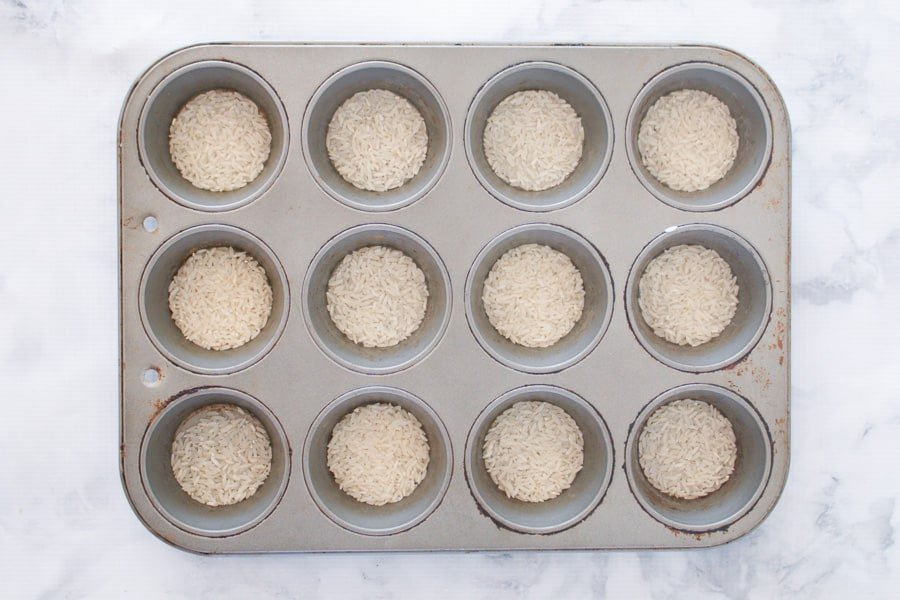 Rice in the bottom of muffin tins.