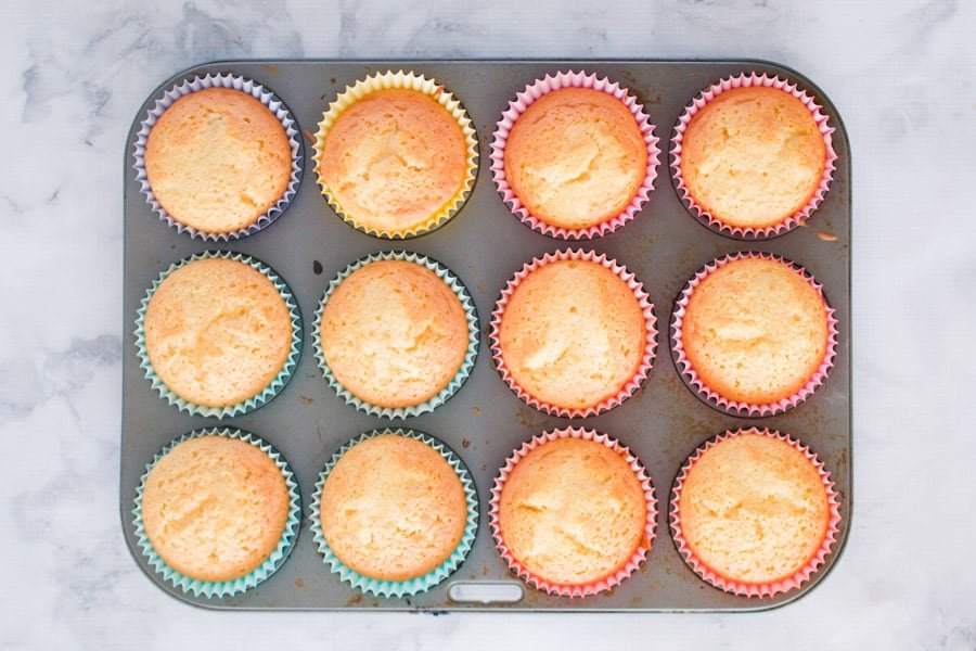 Vanilla cupcakes in a muffin tin.