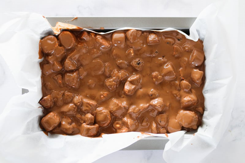 Rocky road being poured into a baking tin.