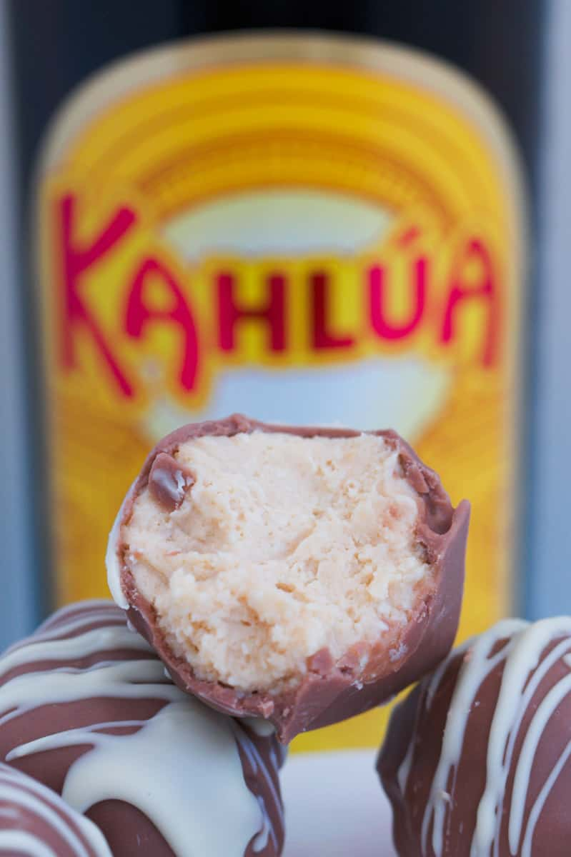 A half-eaten cheesecake ball made with chocolate and Kahlua.