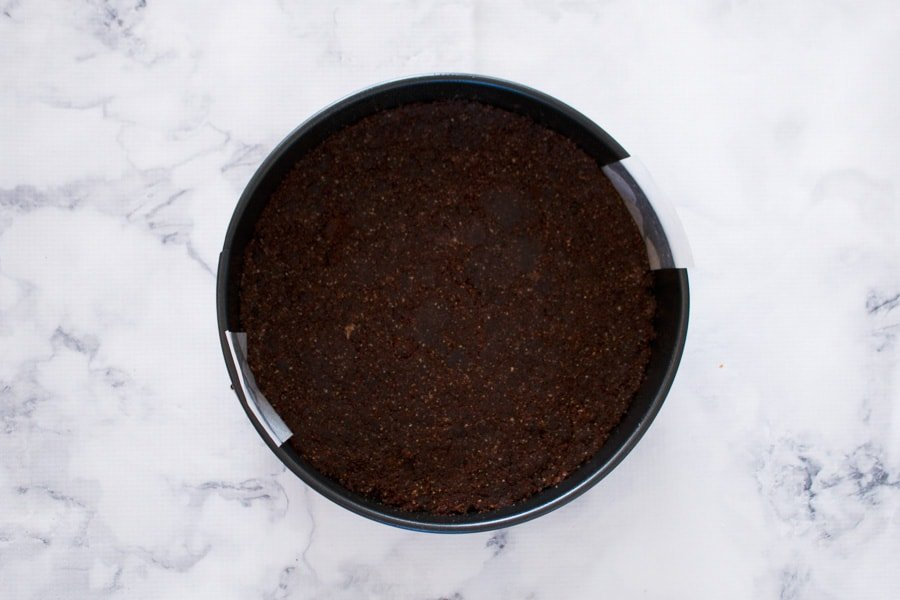 The base of a chocolate cheesecake.