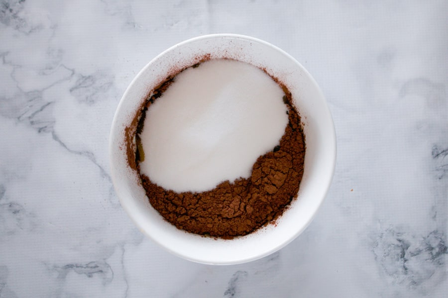 Cocoa powder and sugar in a mixing bowl